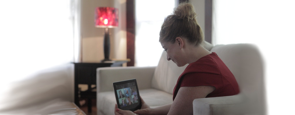 woman doing online substance abuse counseling on an iPad